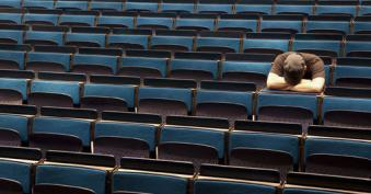 Picture of a student, alone in the auditorium
